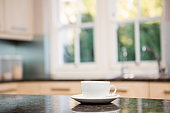 White cup on kitchen counter