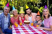 Multi-generation family enjoying at birthday in yard