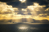 sun rays on the sea with ships