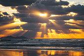 golden sun rays on the sea at sunset