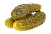 Three marinated pickled cucumbers on white background
