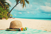hat and sunglasses on tropical vacation