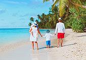 happy family with kids walk on beach