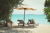 Two chairs on the tropical beach