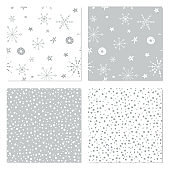 Seamless winter patterns. Set of Christmas backgrounds with hand drawn snowflakes.
