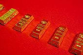 gold bar of replica, Lump of gold, red background