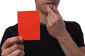 Referee showing red card. Business and sport concept. Exclusion