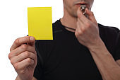 Referee showing yellow card. Business and sport concept. Exclusion