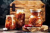 Cabbage kimchi glass jar. Korean traditional cuisine. Fermented food.