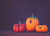 Cute little family of pumpkin characters