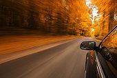 Car speeding on the road