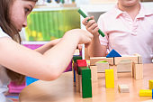 Preschool children in the classroom playing