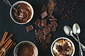 Cocoa, coffee and chocolate chips on dark concrete background.  Baking or cooking concepts