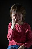 Sad little child, crying, hugging stuffed toy