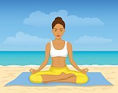 woman meditating on the beach. outdoor yoga workout