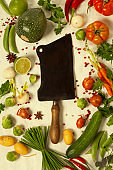 Kitchen knife and organic vegetables
