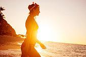Woman walking into ocean