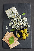 Blue cheese with olive, basil and crispbread