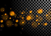 Orange luminous bokeh lights particles background