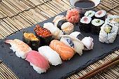 sushi on stone board