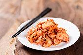 Korean food, kimchi cabbage on white dish
