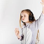 Cute little girl in headphones