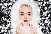 Fashion Woman on Snowfall Winter Background