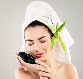 Spa Model Woman with White Bath Towel and Natural Green Leaves. Healthcare, Skincare and Spa Concept