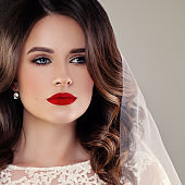 Beautiful Bride Fashion Model, Closeup Wedding Portrait. Woman Fiancee with Curly Hairstyle and Event Makeup