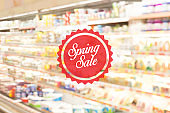 Blurred Background: Shopping at mall concept with Spring Sale label