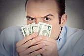 greedy banker executive CEO boss, corporate employee funny looking man holding dollar banknotes