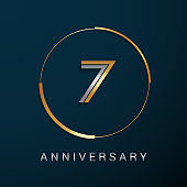 7 Years Anniversary icon with  Gold and Silver Multi Linear Number in a Golden Circle , Isolated on Dark Background