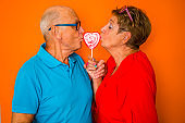 Color Surge for Stylish Seniors, couple kiss heartshaped lolly