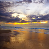 Beautiful sandy beach of the Indian Ocean and a fantastic sunset.