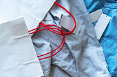 shirt, price tag and shopping bag
