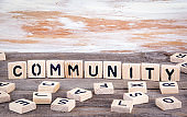 Community from wooden letterson on wooden background