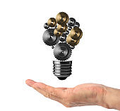 Gears in the shape of a floating light bulb on the hand