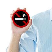 Young man holding No Smoking sign