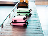 Baggages on conveyor belt in a line