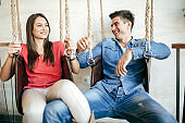 Young couple relaxing in swing
