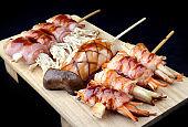 Bacon roll with enoki mushroom grilled.