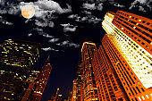 Full moon over buildings in Chicago, Illinois, USA