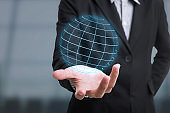 Business hand with application icon interface and globe networking system. concept technology social network communication.