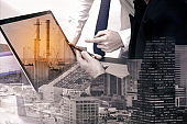 Double exposure business worker with factory industry construction. concept success investment.