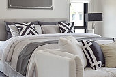 Modern classic style bedding with comfortable sofa in the bedroom