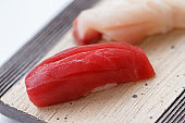 Closed up Maguro Sushi on the Stone Plate.