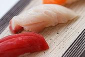 Closed up Hamachi Sushi on the Stone Plate.