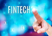 Finger point to Fintech word with bitcoins icon link network together on blue abstract background,Digital Financial business concept