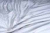 Top view of white bedding striped textile, Elegant textile on bed