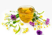 Herbal medicine. Cup of lime blossom tea with chamomile flowers and cornflower. linden tea on a white background